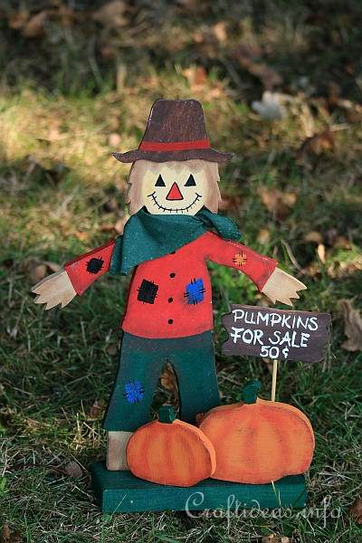Wooden Scarecrow and Pumpkins